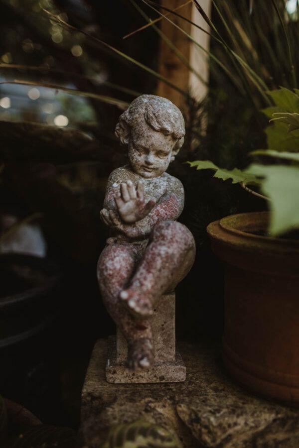 antique stone cherub